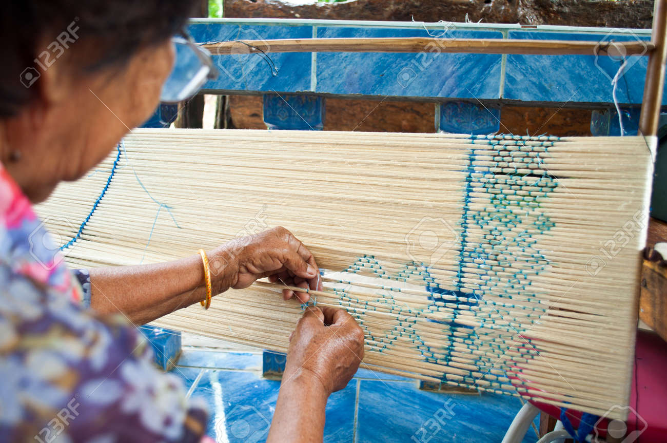Process of weaving, dyeing, weaving ancient Thailand as silk ,at Roi Ed , Thailand Stock Photo - 24376280