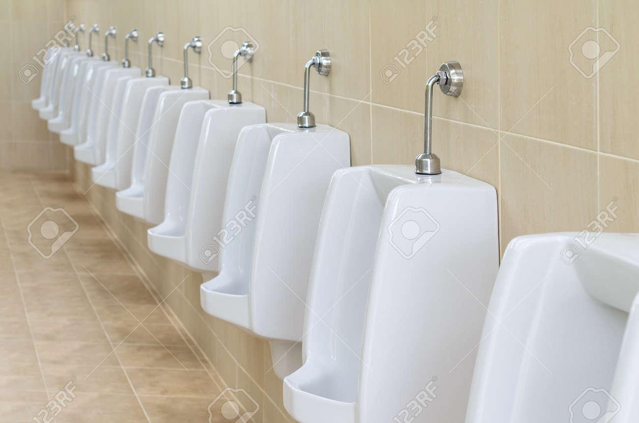 Closeup White Urinals In Men\'s Bathroom, Design Of White Ceramic ...