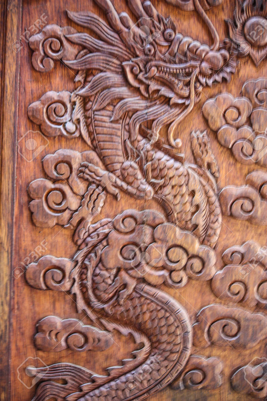 Door wood panel carves manually dragon picture stock photo door wood panel carves manually dragon picture stock photo 19600665 voltagebd Choice Image