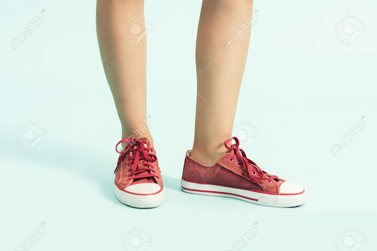 Women shoes. sports shoes ,sneakers. Closeup of woman legs and..