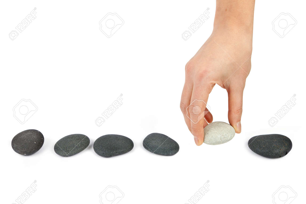 Human hand arranging line of pebbles Stock Photo - 15376016