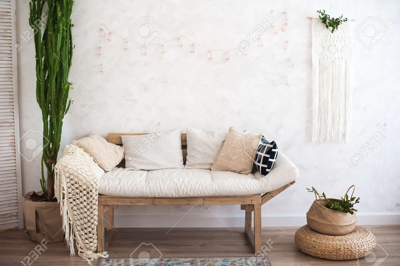 Beautiful spring decorated interior in white textured colors...