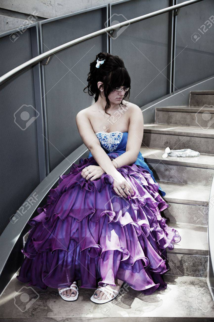 A Young Girl Sits Alone In Her Prom Dress On A Lonely Flight.. Stock ...