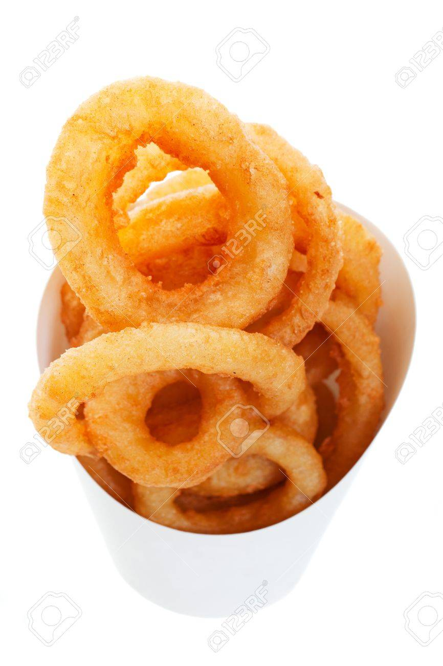 Golden brown, deep fried onion rings in a generic takeout container.  Shot on white background. Stock Photo - 7092244
