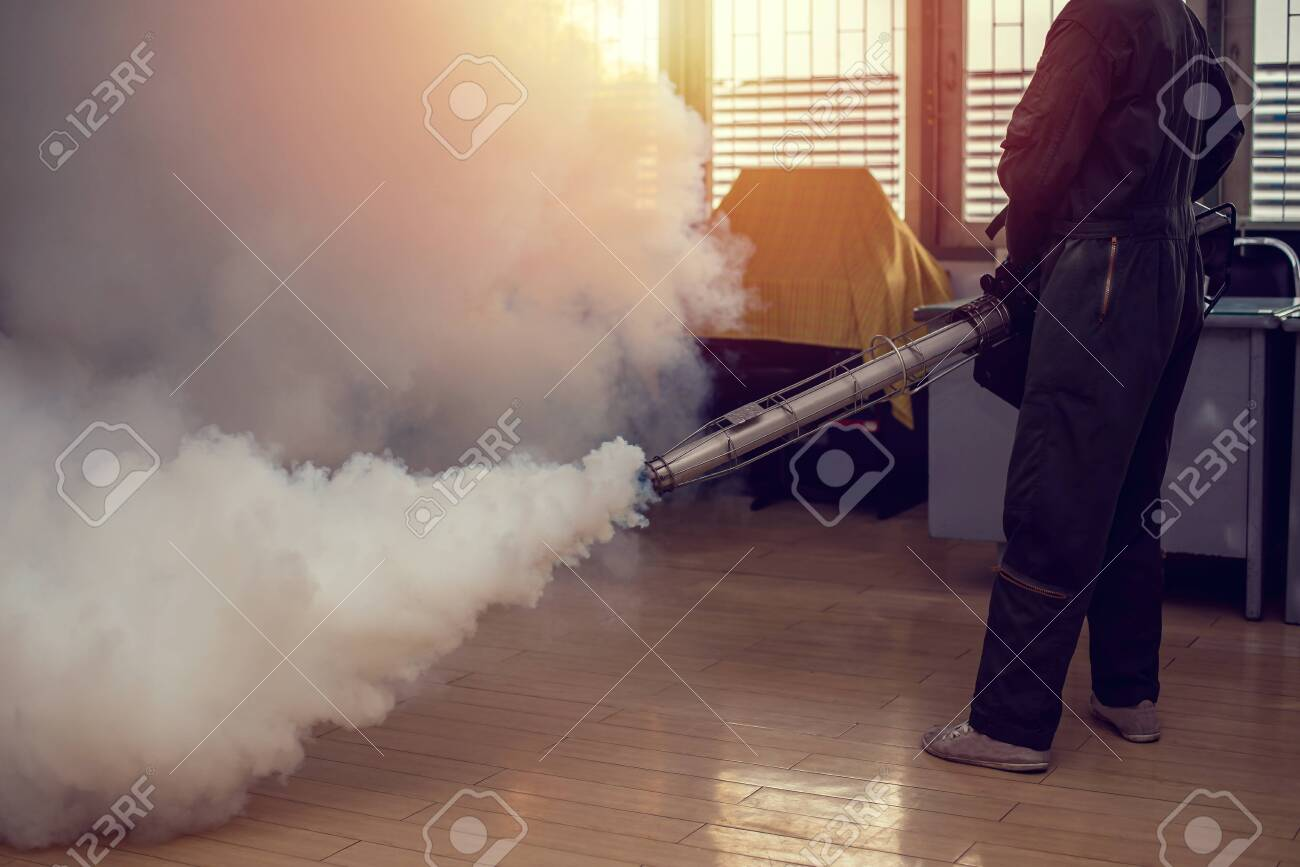 Man work fogging to eliminate mosquito for preventing spread dengue fever and zika virus - 132084485
