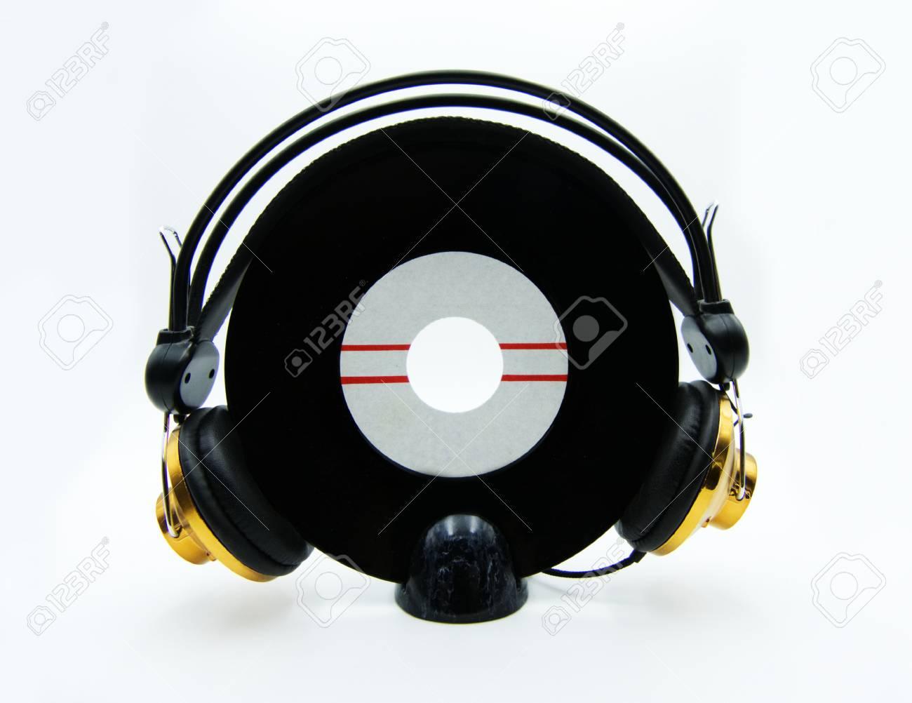 Vinyl single record with golden headphones on white background - 125366834