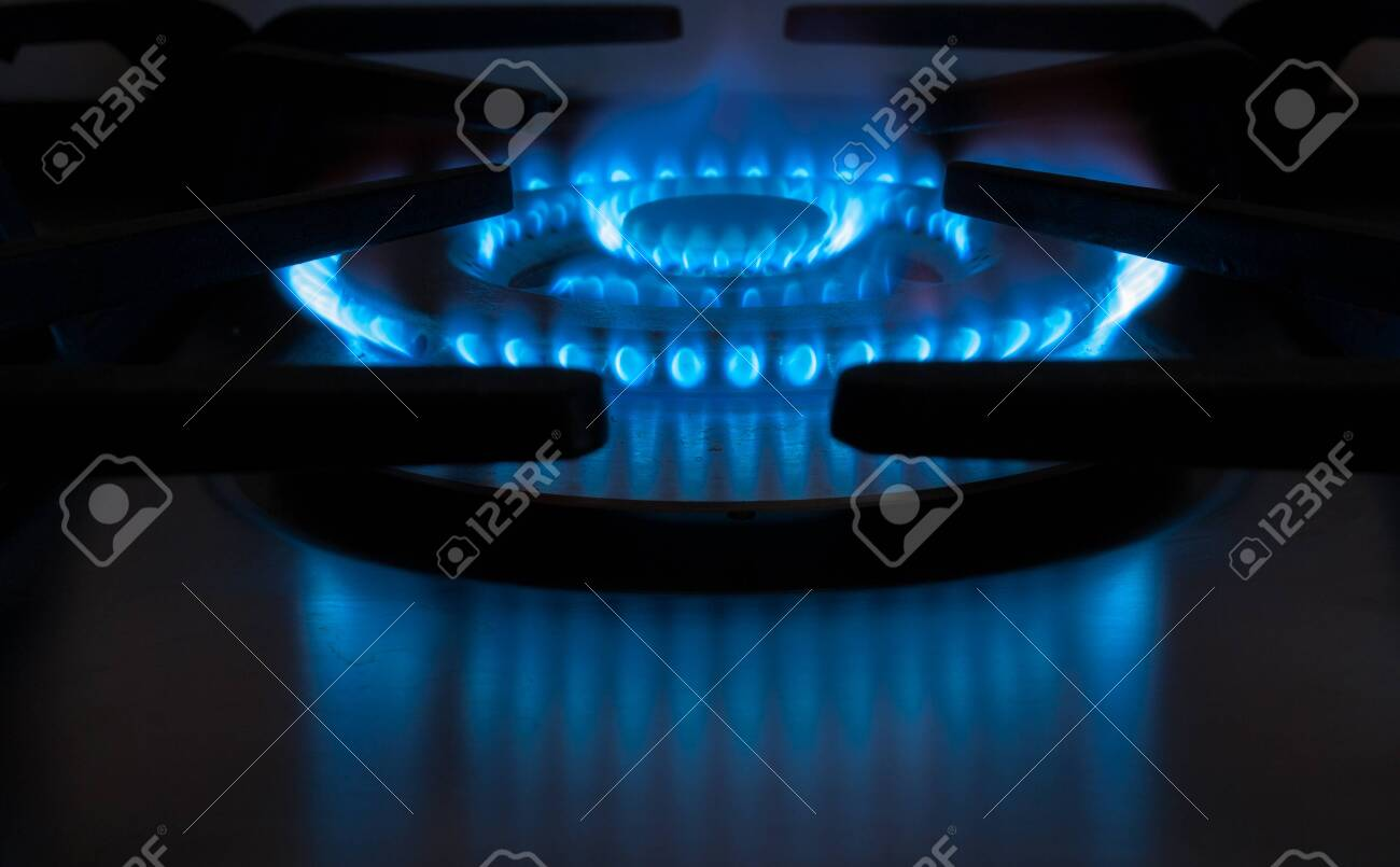 cookers home kitchen with the typical blue flame Stock Photo - 26560756