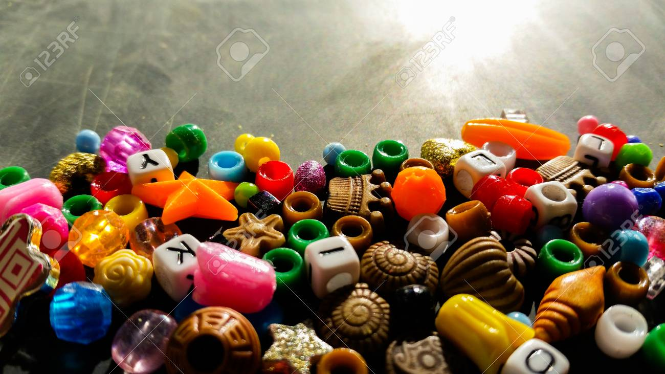 Colored beads are used to make bracelets and necklaces - 92820116
