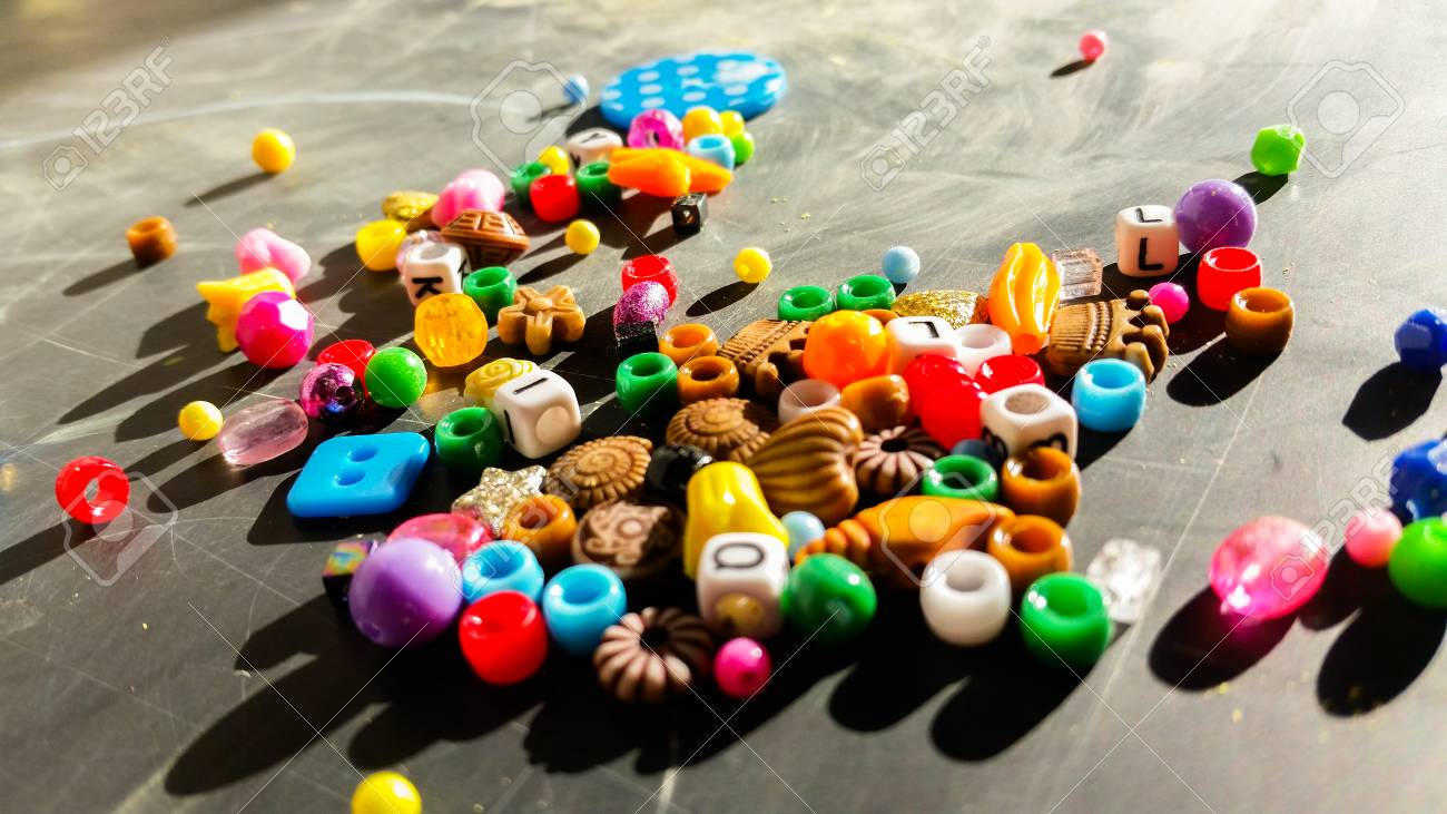 Colored beads are used to make bracelets and necklaces - 92883039