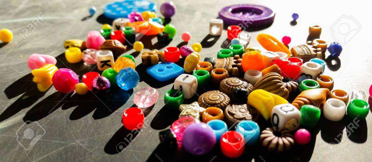 Colored beads are used to make bracelets and necklaces - 92821320