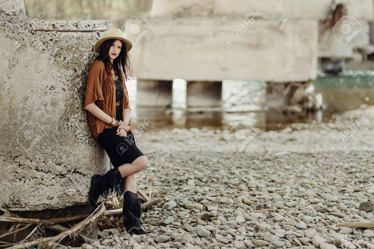Stock Photo Stylish Boho Woman With Jewelry Posing At River Beautiful Gypsy Dressed Girl With Hat And Fringe Poncho With Sensual Look Young Girl