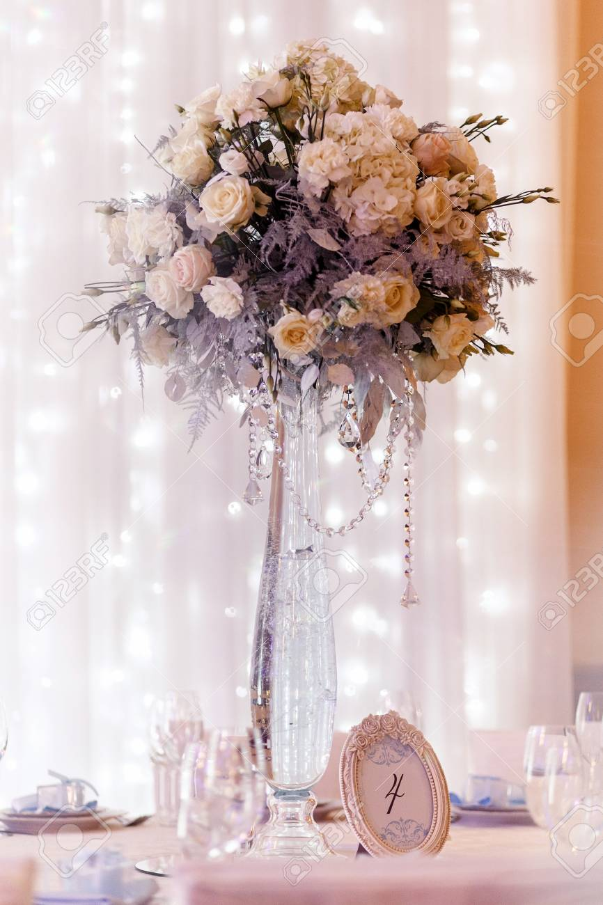 123RF.com & luxury wedding decor with flowers and glass vases and number..