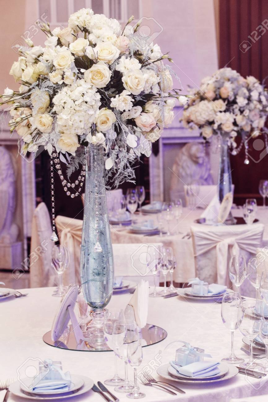 luxury wedding decor with flowers and glass vases with jewels on round tables. arrangements of & Luxury Wedding Decor With Flowers And Glass Vases With Jewels ...