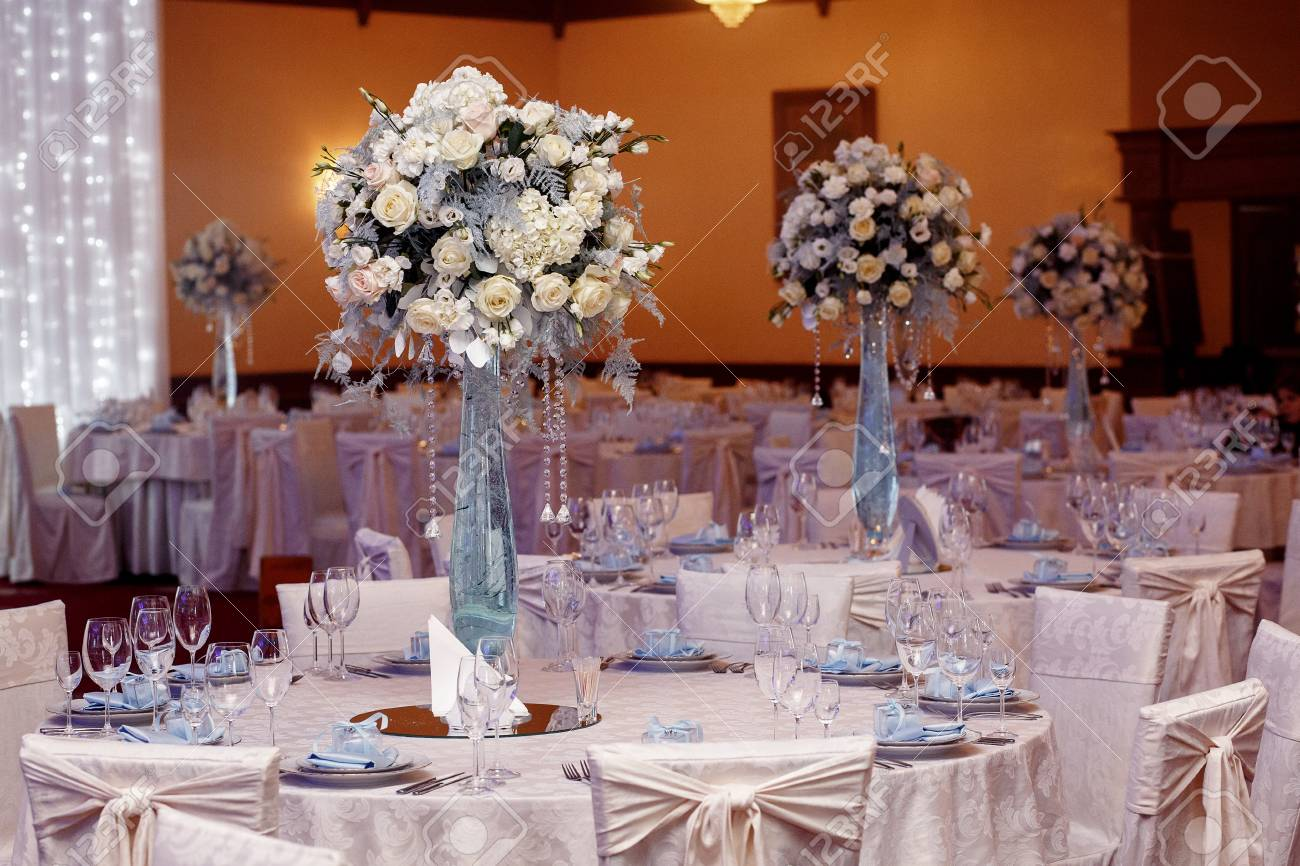 Luxury Wedding Decor With Flowers And Glass Vases With Jewels