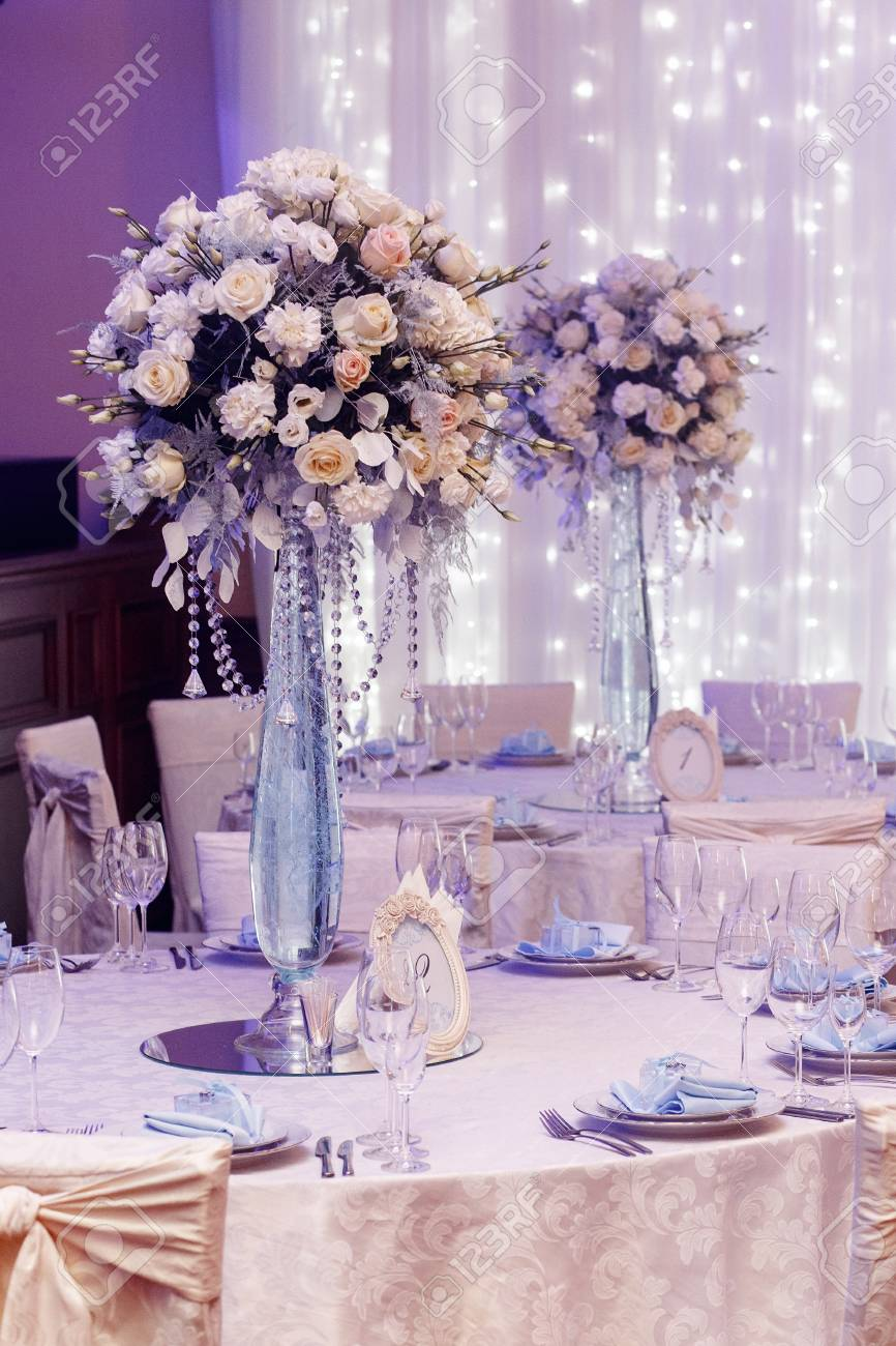 Luxury Wedding Decor With Flowers And Glass Vases And Number