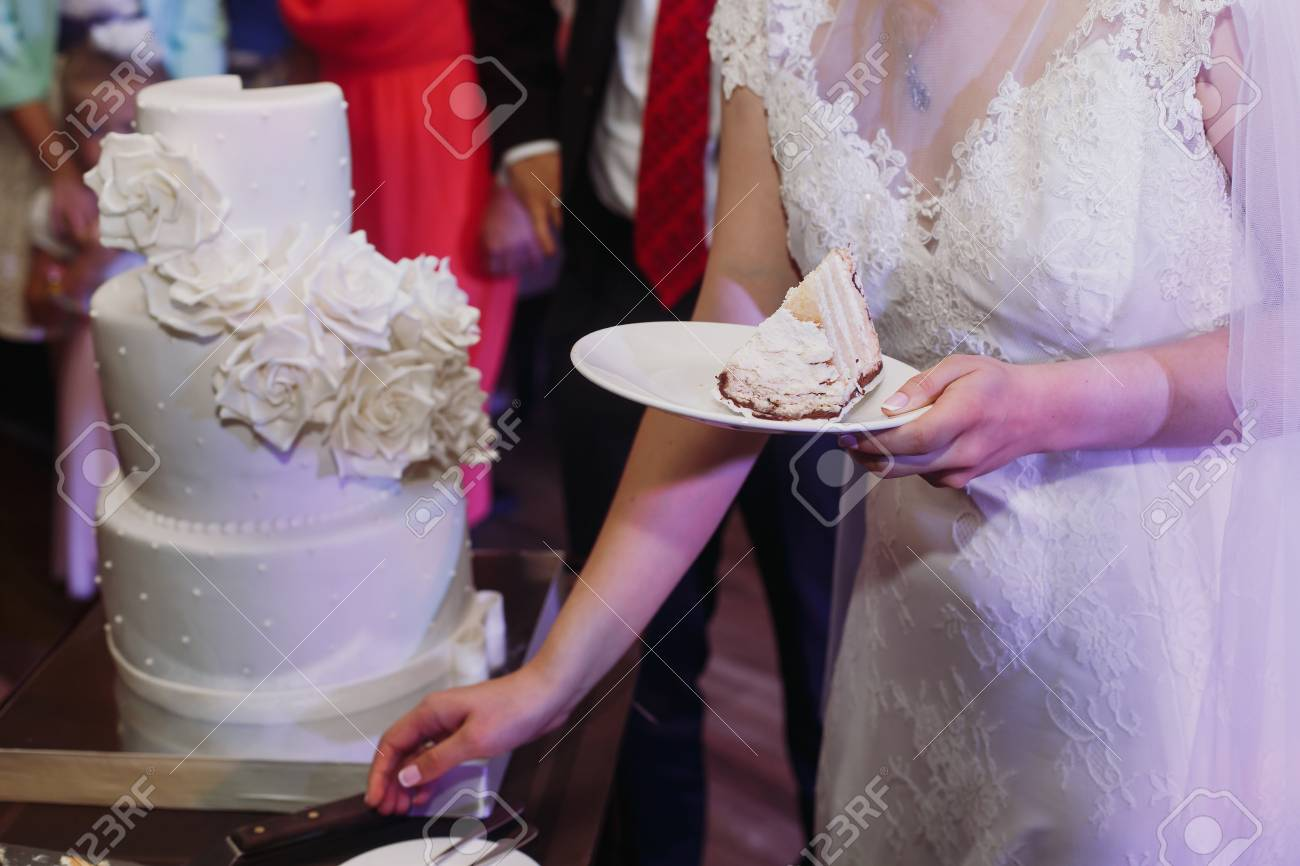 Bride Holding Piece Of Wedding Cake For Tasting Together With Stock Photo Picture And Royalty Free Image Image 75683964