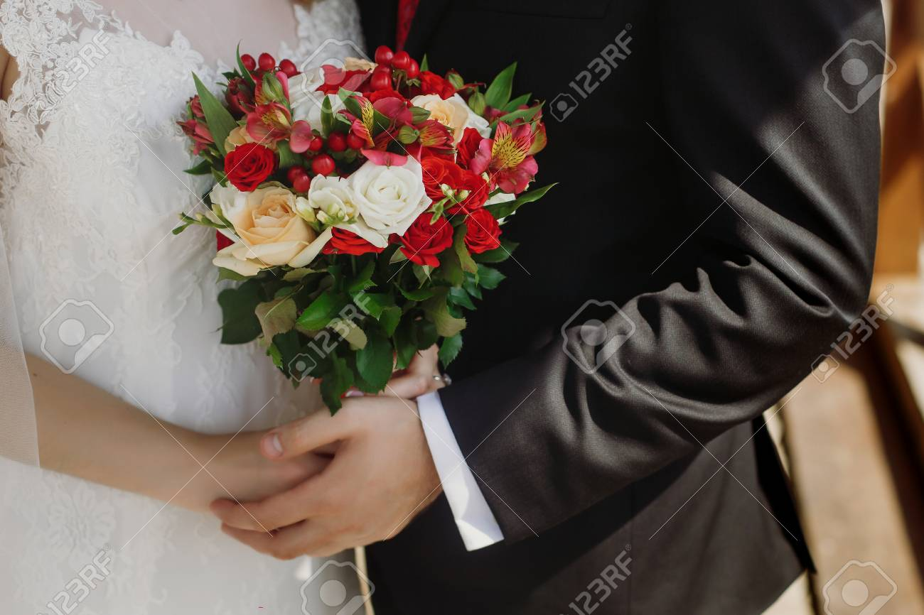 Red Roses Wedding Bouquets.Wedding Bouquet Of Red Roses Orchids Stylish Wedding Couple