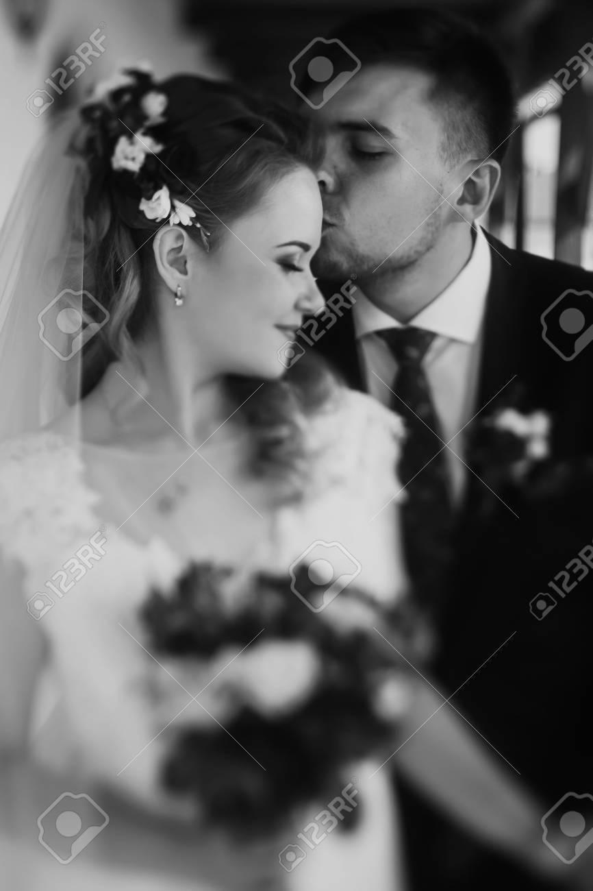 Stylish Wedding Couple Hugging And Posing Luxury Bride And Groom