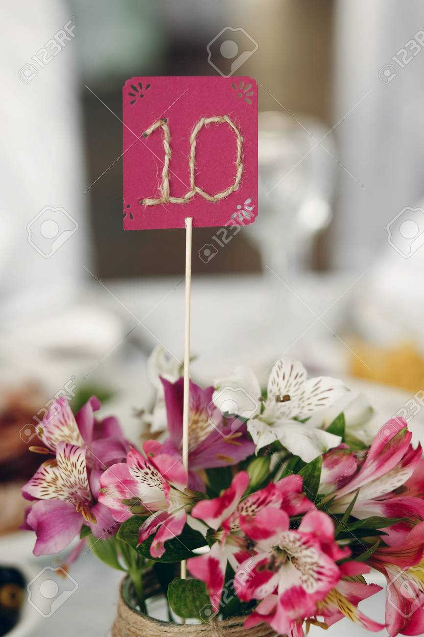 Cute Handmade Table Number Closeup At Wedding Reception In Luxury - Table numbers restaurant supplies