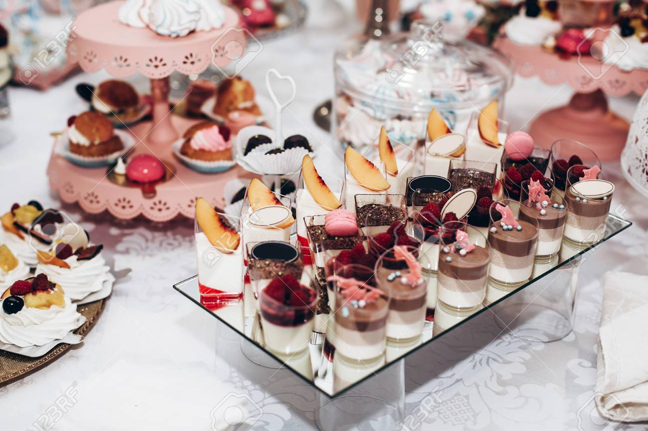 delicious candy bar at luxury wedding reception exclusive expensive catering table with modern desserts