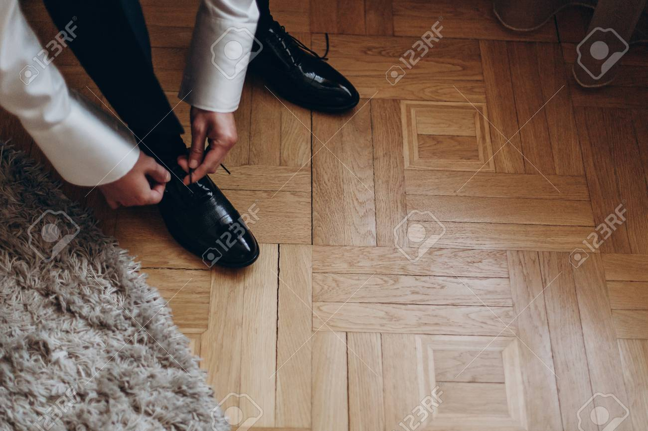Groom Tying Shoes Getting Ready In The Morning On Wooden Floor