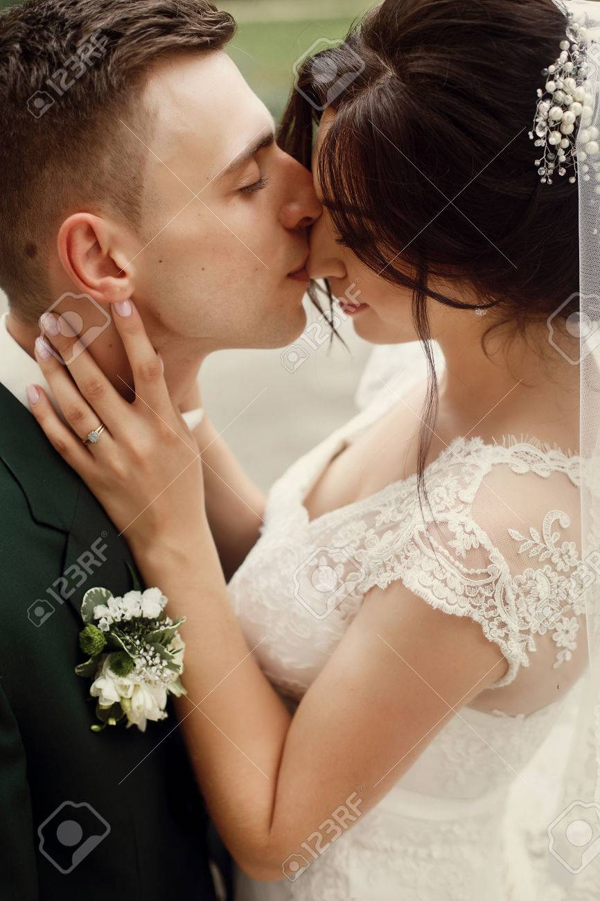 Gorgeous Brunette Bride In Lace White Wedding Dress Kissing Handsome ...