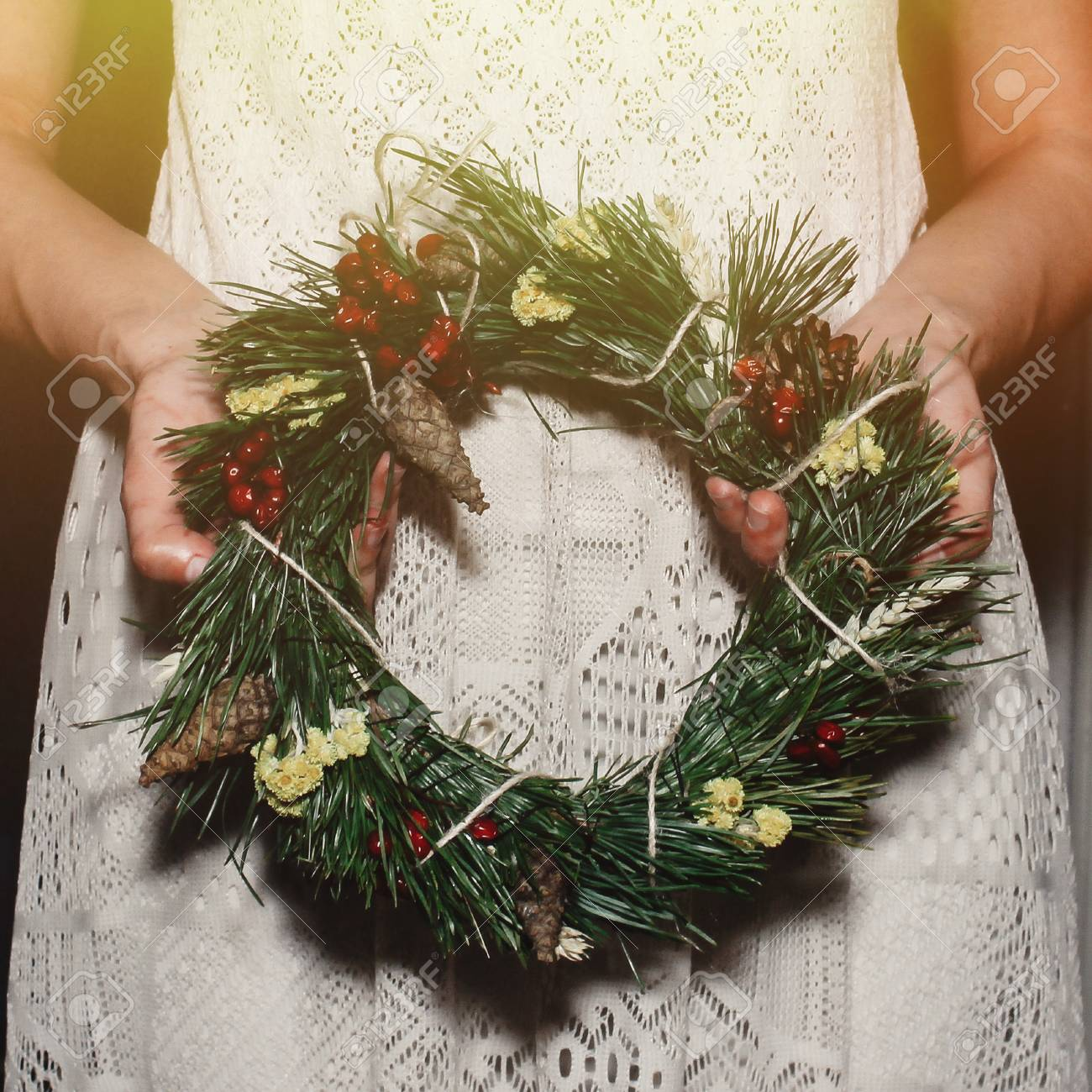 Boho Woman Holding Christmas Wreath In Hands In Light Seasonal Stock Photo Picture And Royalty Free Image Image 75746387