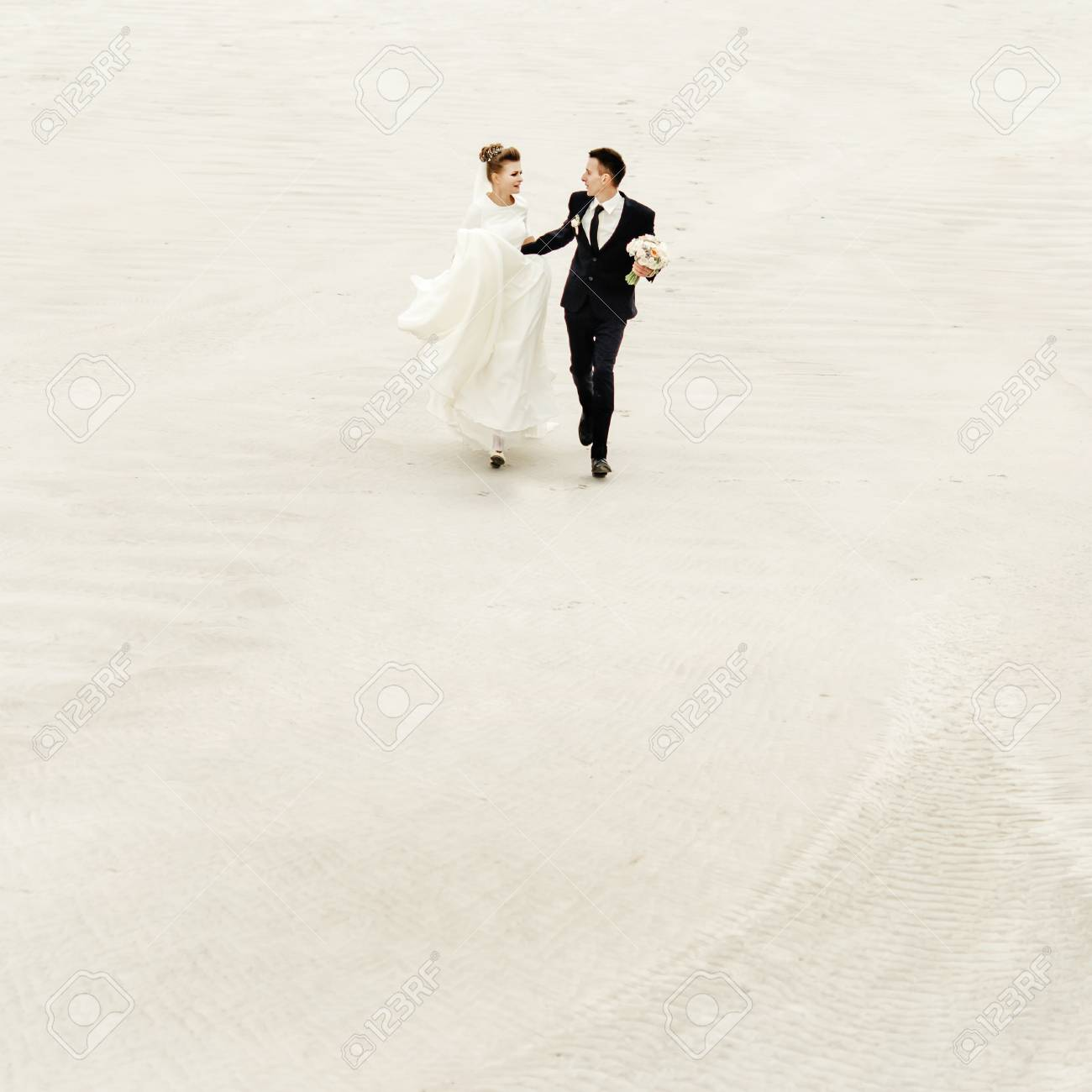 Peachy Happy Bride And Groom Running And Having Fun At Sandy Beach Lake Download Free Architecture Designs Scobabritishbridgeorg