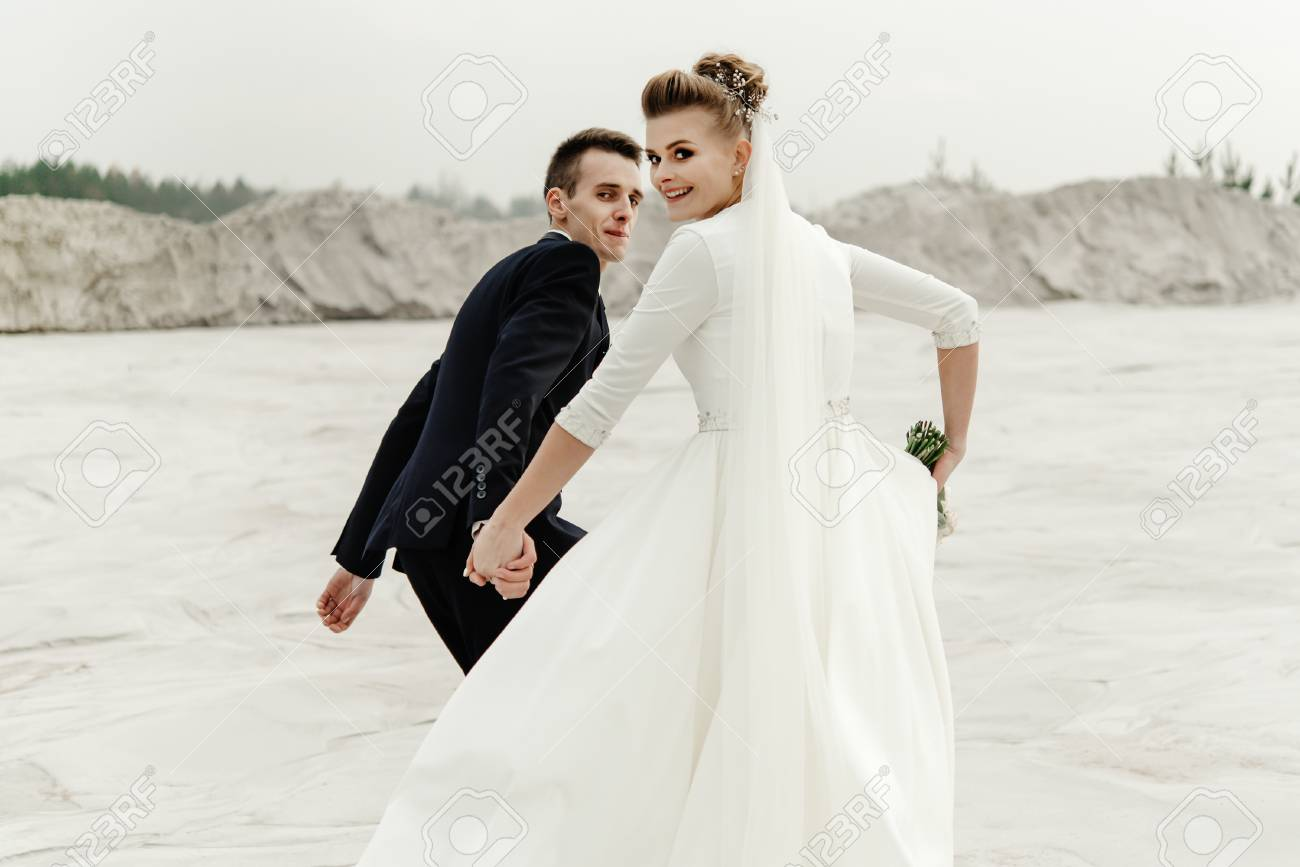 Surprising Happy Bride And Groom Running And Having Fun At Sandy Beach Lake Download Free Architecture Designs Scobabritishbridgeorg