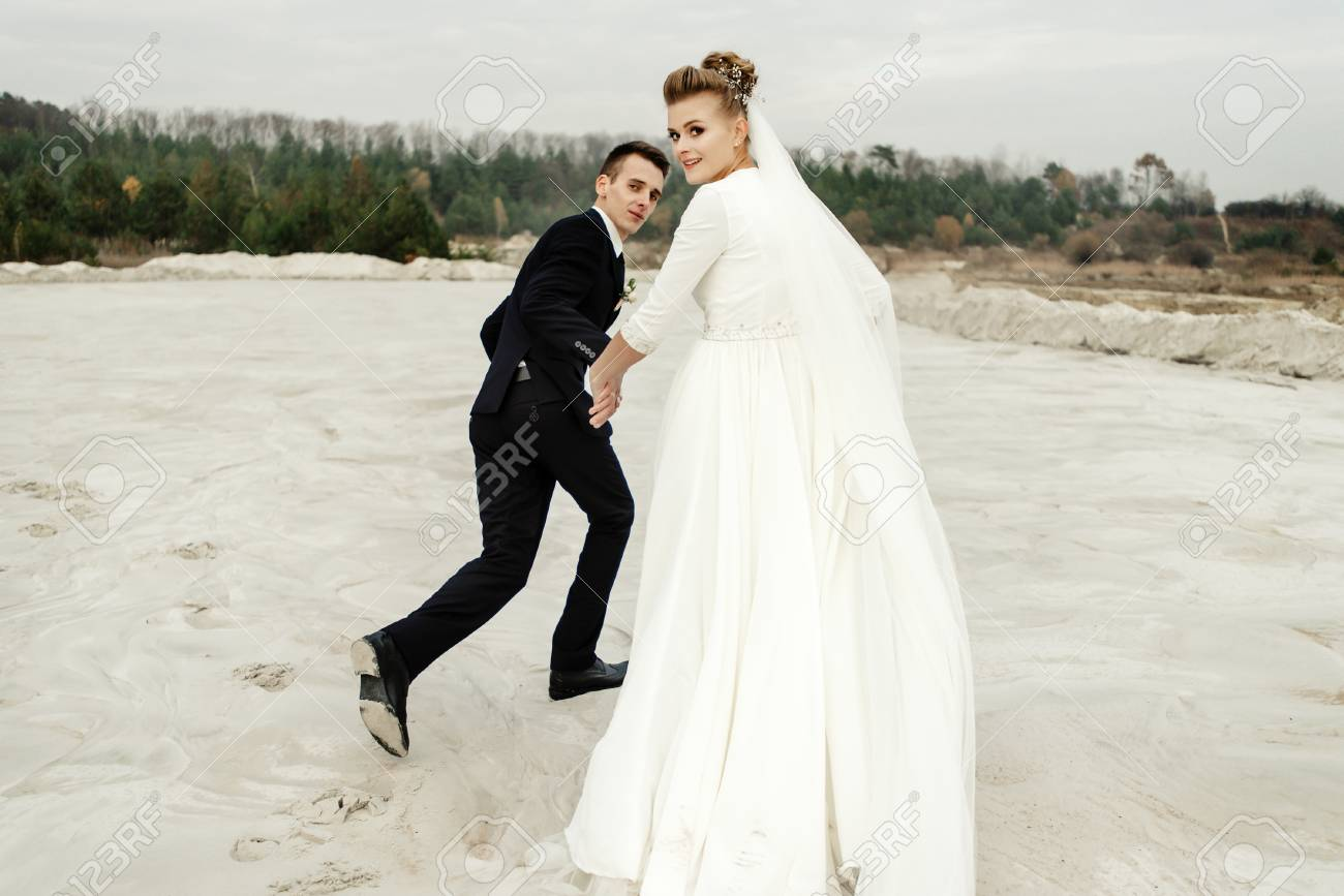 Groovy Happy Bride And Groom Running And Having Fun At Sandy Beach Lake Download Free Architecture Designs Scobabritishbridgeorg