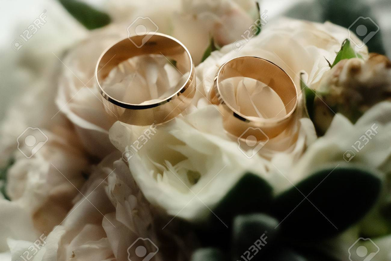 Two Luxury Golden Wedding Rings And Stylish Elegant Bouquet At
