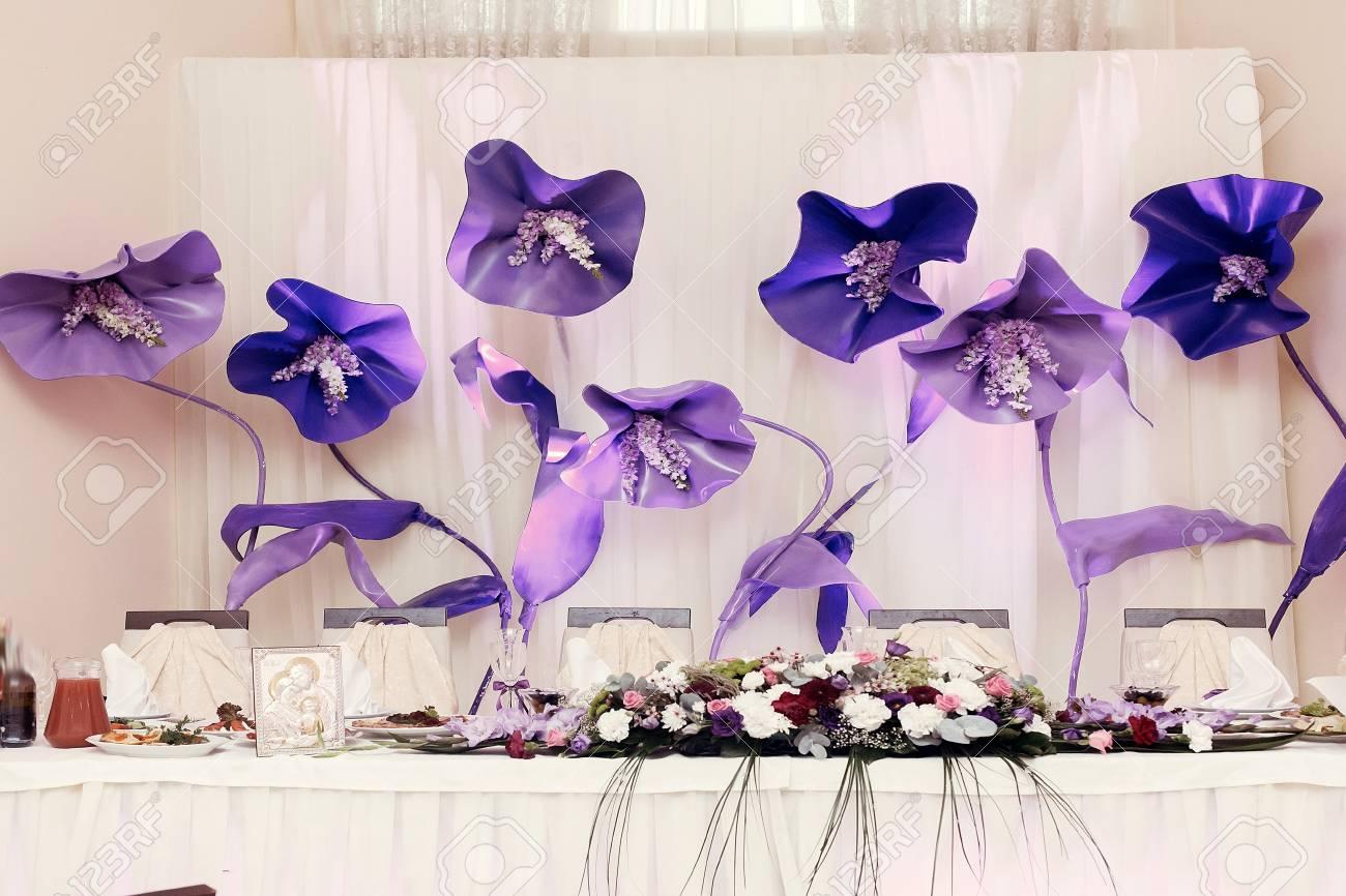 Big purple flowers at wedding centerpiece for bride groom setting big purple flowers at wedding centerpiece for bride groom setting in restaurant luxury wedding reception mightylinksfo