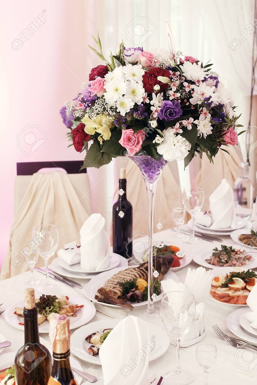 Beautiful Rustic Bouquets Flowers In Vases At Wedding Tables Stock Photo Picture And Royalty Free Image Image 77683474