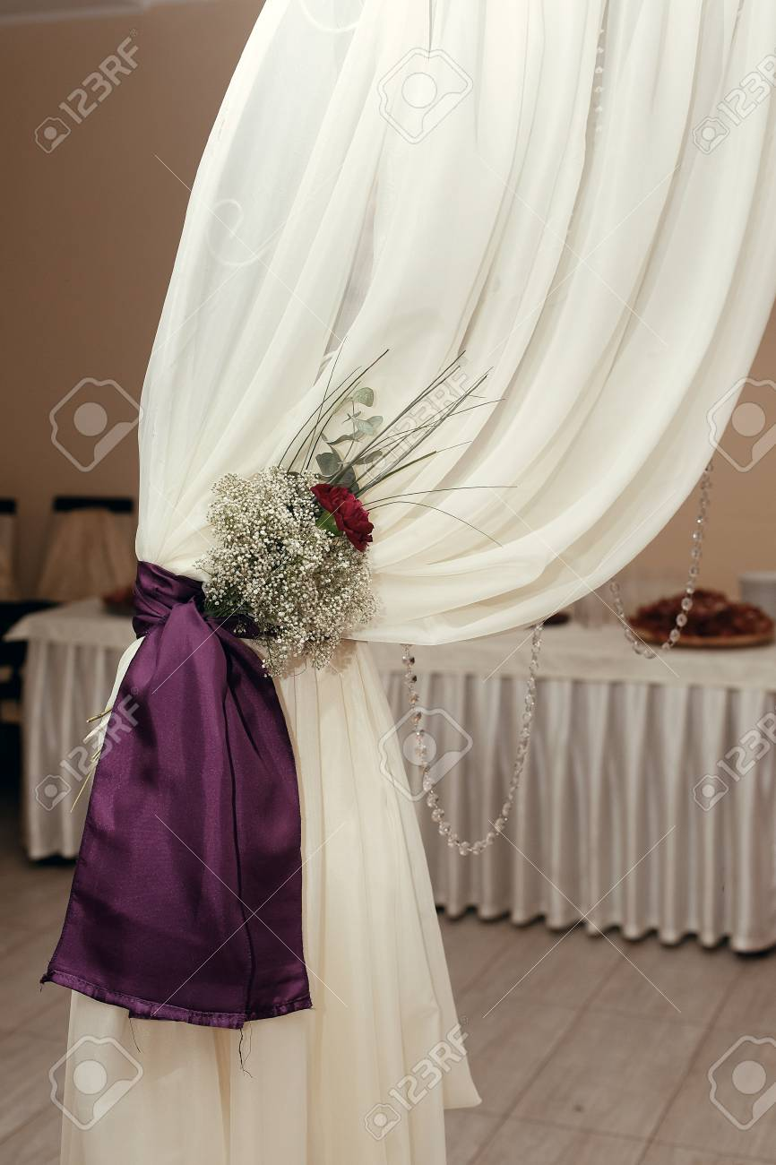 White Arch Detail With Purple Ribbons And Roses In Restaurant ...