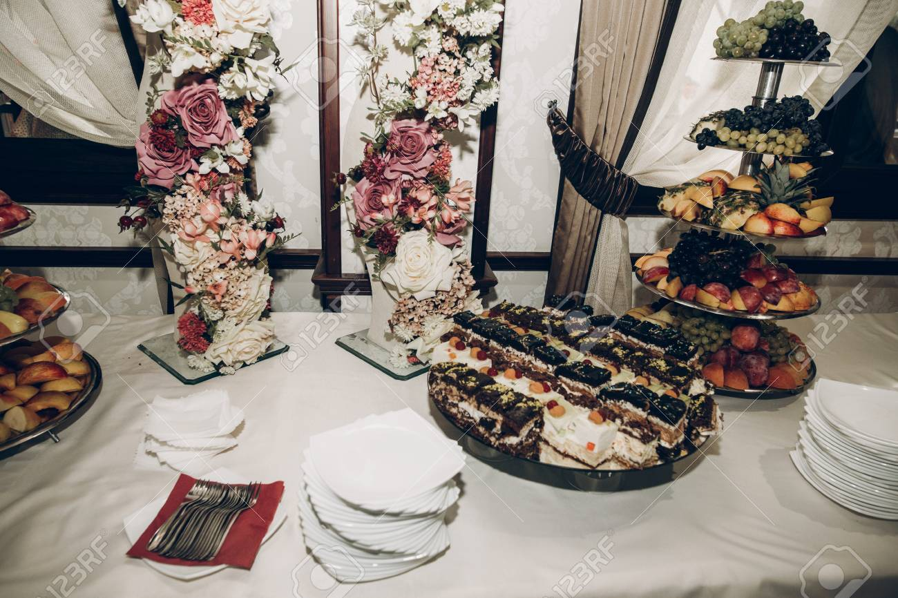 Candy Bar Table At Wedding Reception With Stylish Flowers Decor