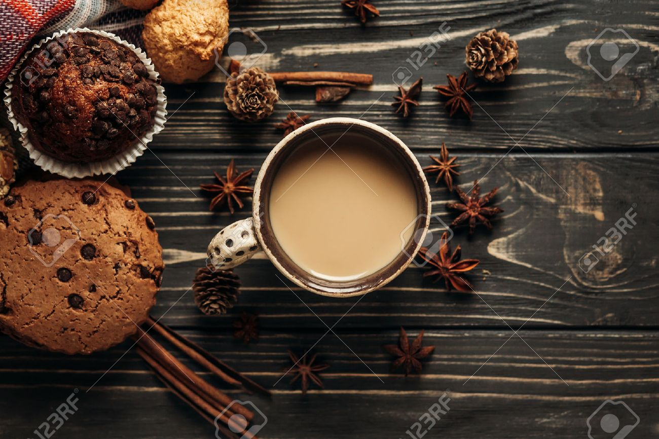 aromatic coffee cookies and anise flat lay on wooden background, stylish rustic winter wallpaper. space for text. cozy mood autumn. seasonal holidays concept - 82445548