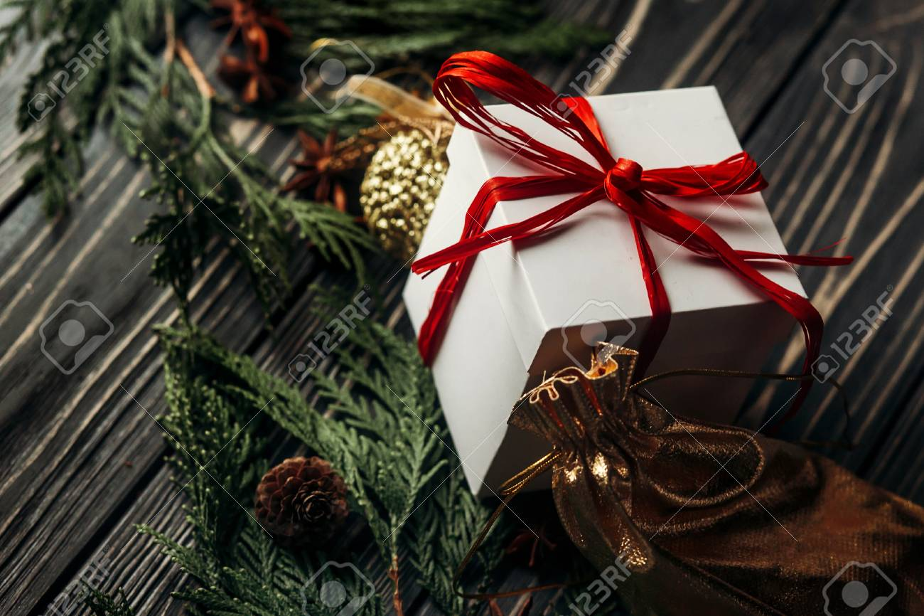 Stylish Rustic Christmas Wallpaper With Presents With Red Ribbon Stock Photo Picture And Royalty Free Image Image 82445914