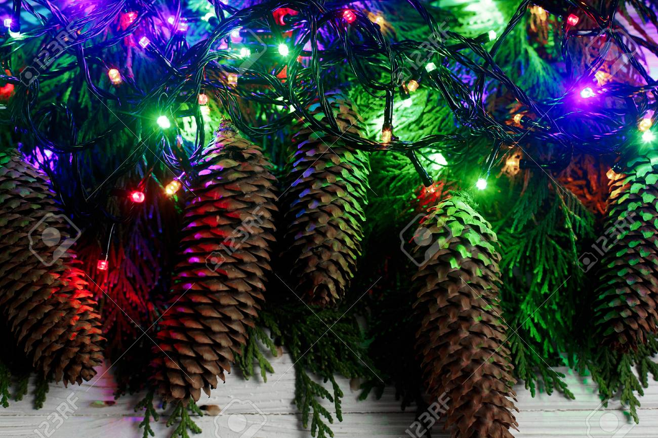 Christmas Garland Lights And Pine Cones On Fir Branches Stylish