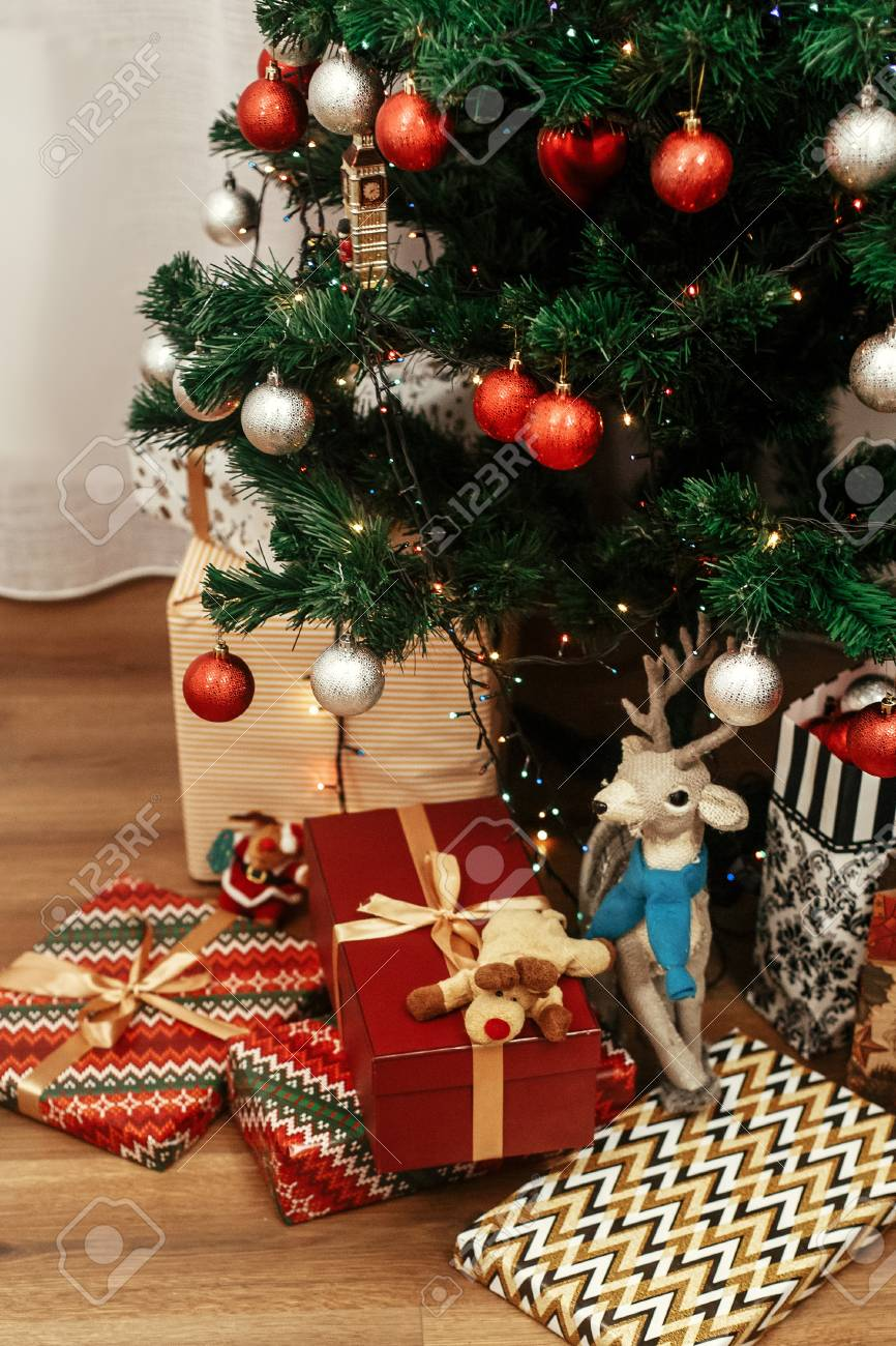 Luxury Christmas Presents Toys In Modern Wrapping Paper Stylish Golden Gifts Under Beautiful Tree