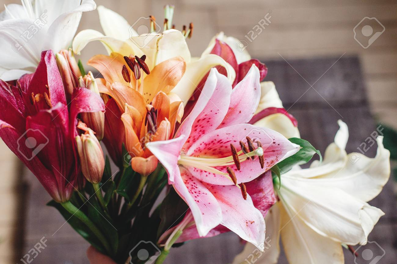 Beautiful Colorful Lily Flower Bouquet On Rustic Wooden Background