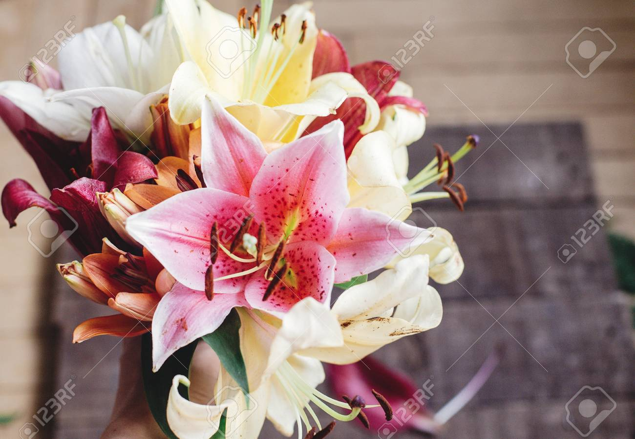 Beautiful Colorful Lily Flower Bouquet On Rustic Wooden Background ...