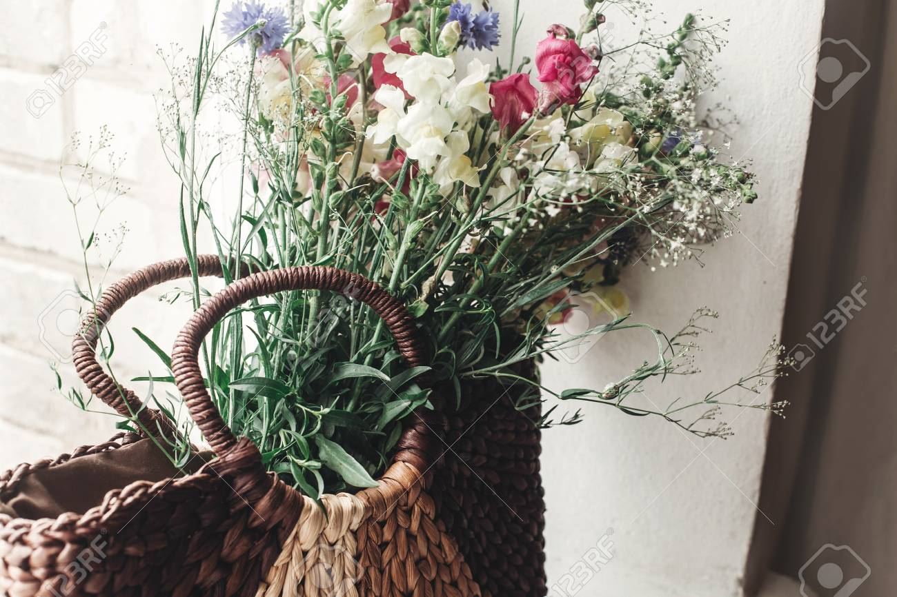 wildflowers in wicker bag on rustic white window colorful flowers rh 123rf com
