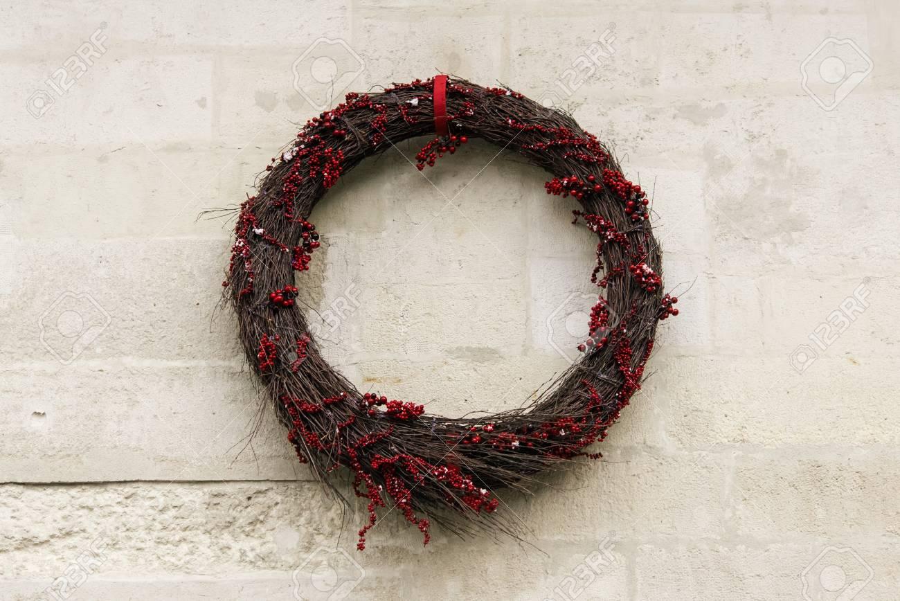 stock photo stylish minimal simple christmas wreath on old wall celebration decoration for holidays in the city - Simple Christmas Wreaths