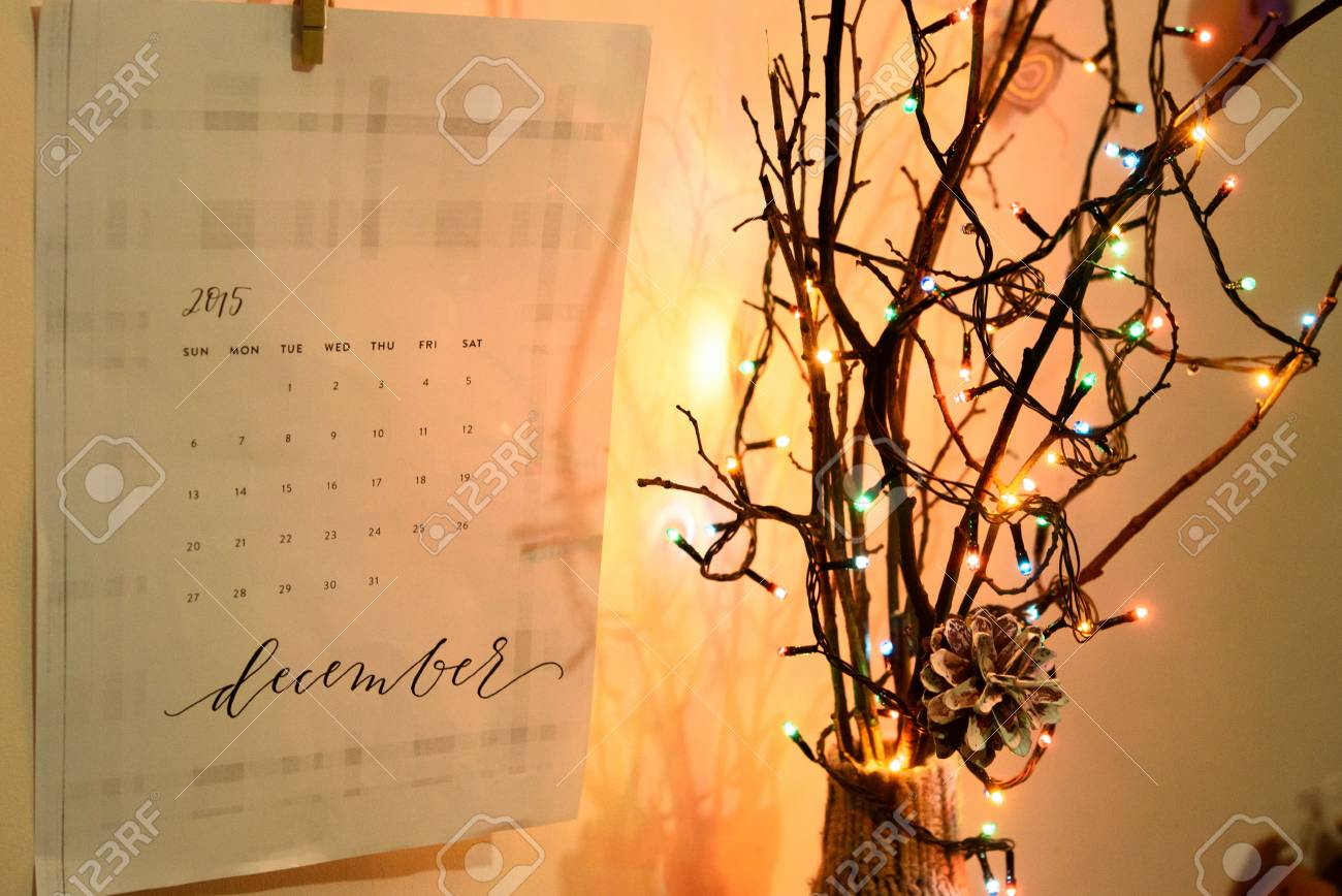 Stylish Creative Calender On The Wall And Christmas Garland Lights