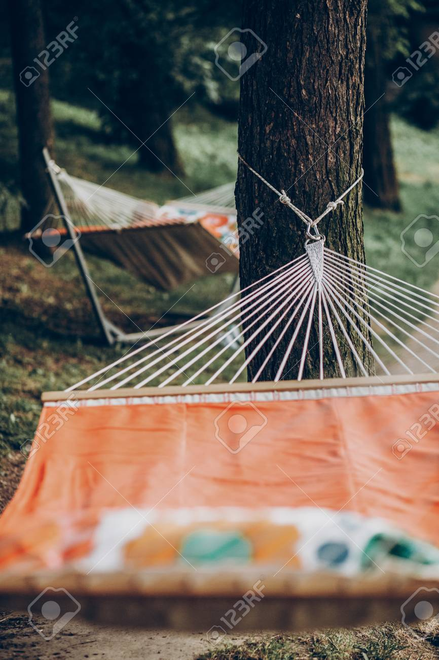 Comfortable Orange Hammock Hanging Outdoors In A Park Boho Hammock