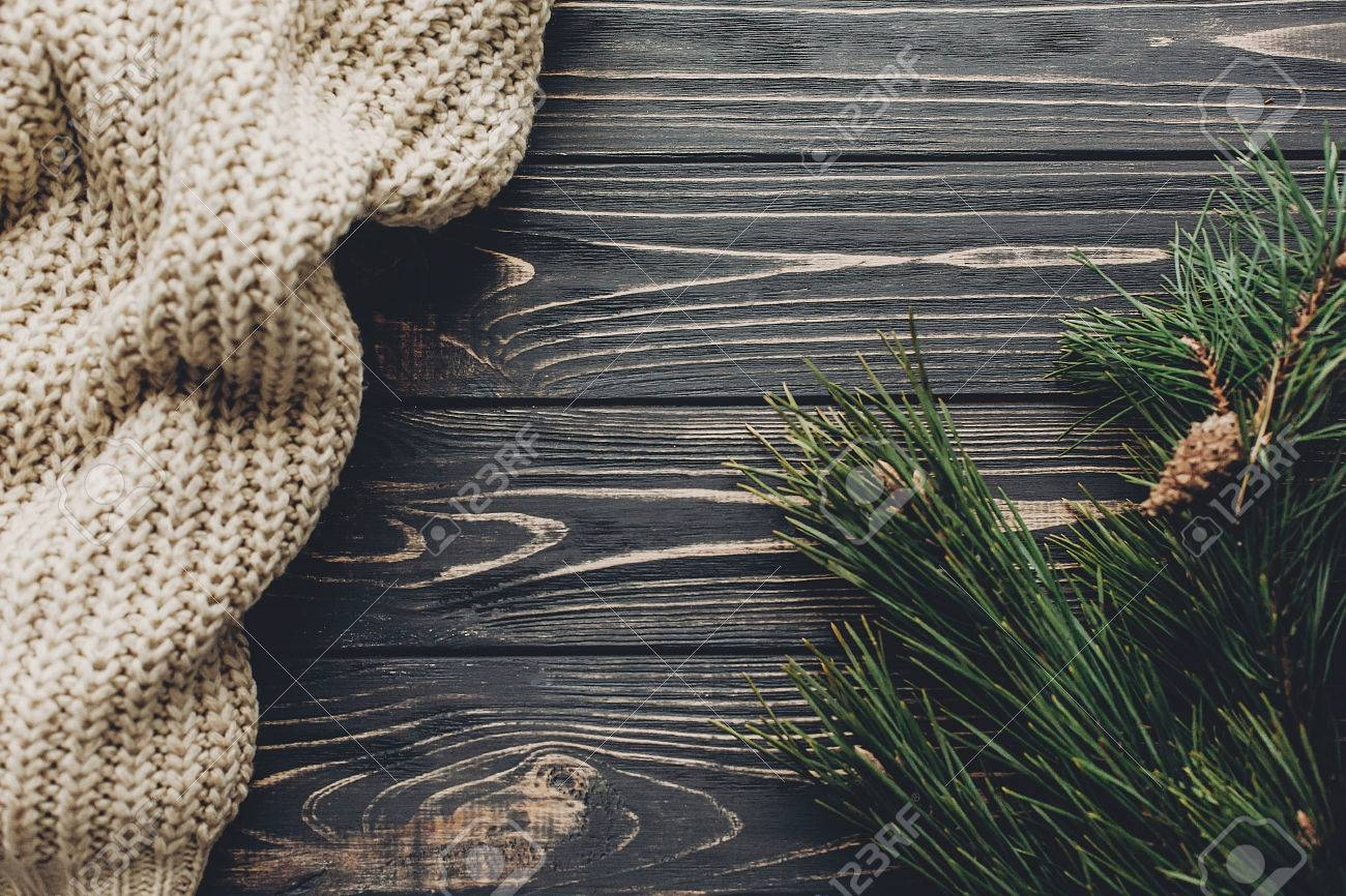 Winter Flat Lay Warm Cozy Sweater On Rustic Background With Stock