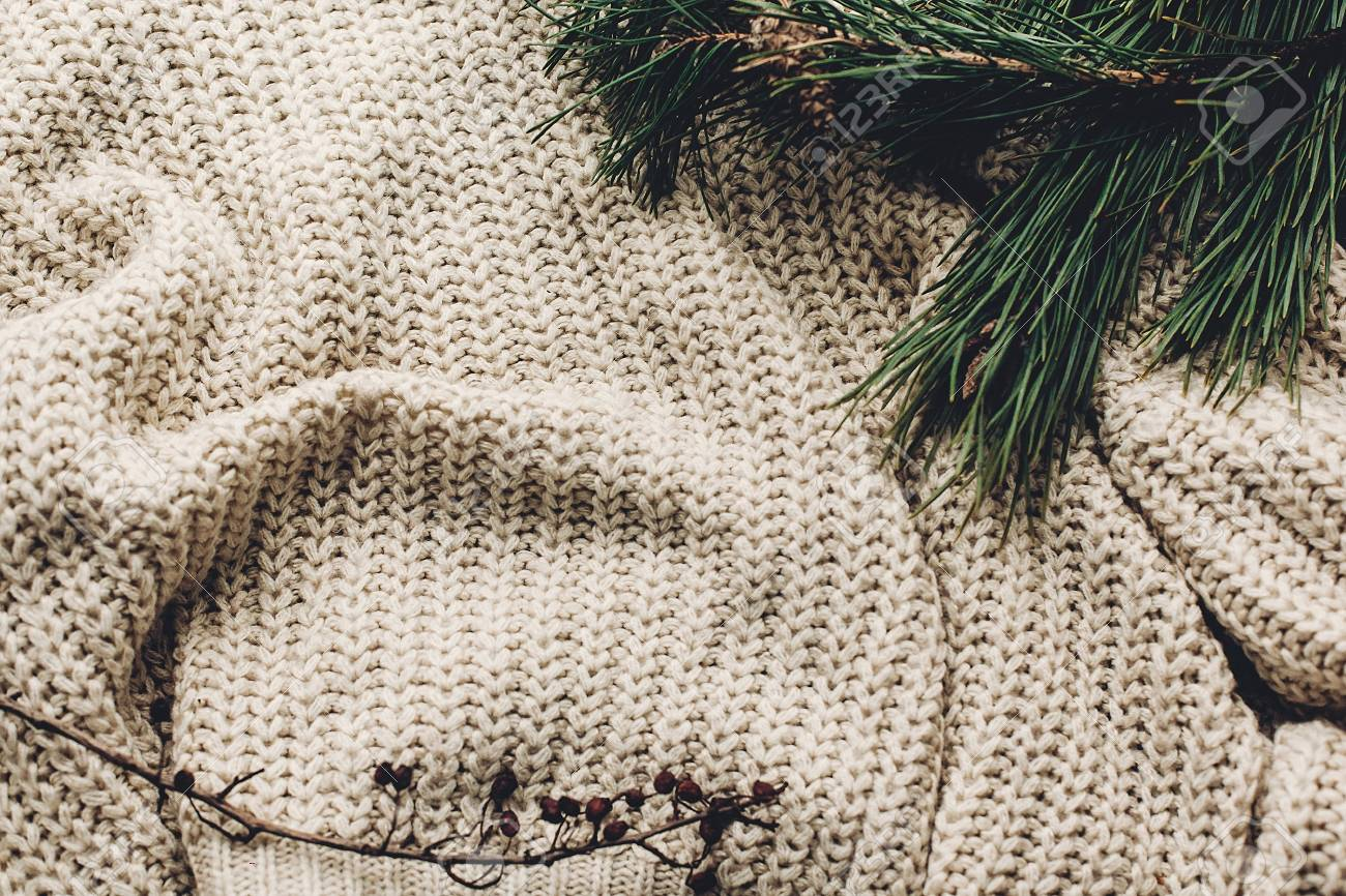 Warm Cozy Sweater On Rustic Background With Fir Green Branches
