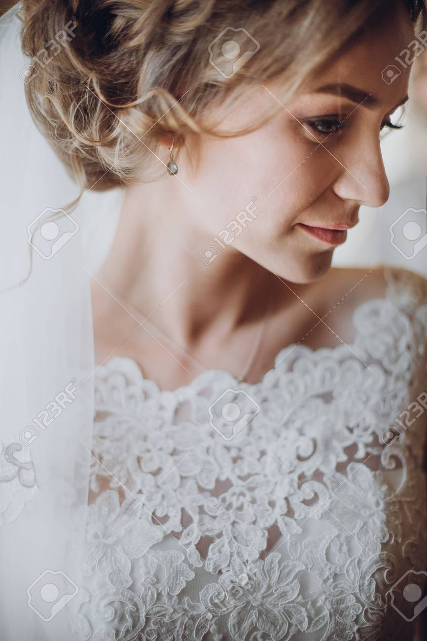 Beautiful Blonde Bride In Elegant White Lace Wedding Dress And ...