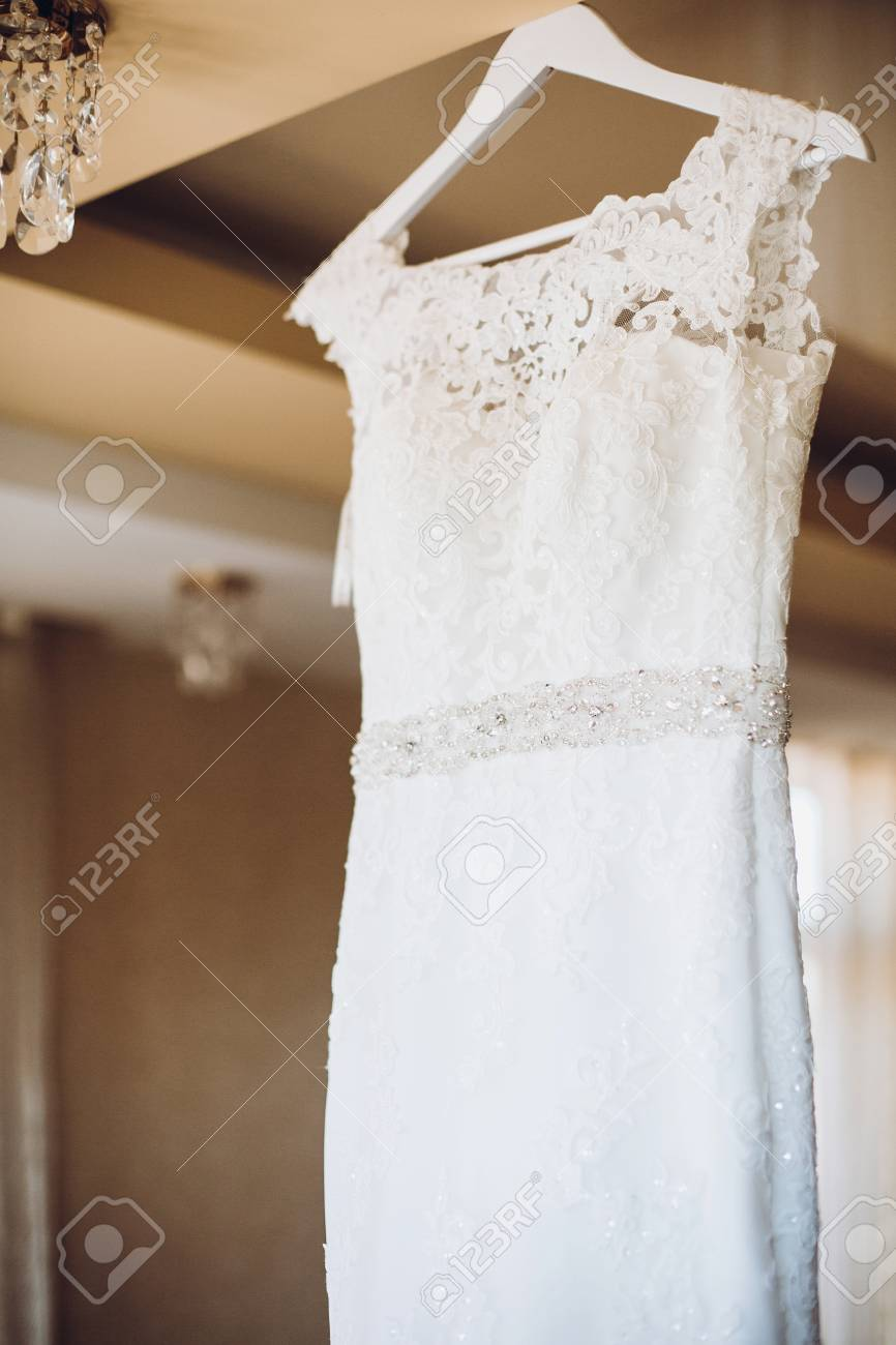 Beautiful Lace Wedding Dress On White Wooden Hanger In Provence ...