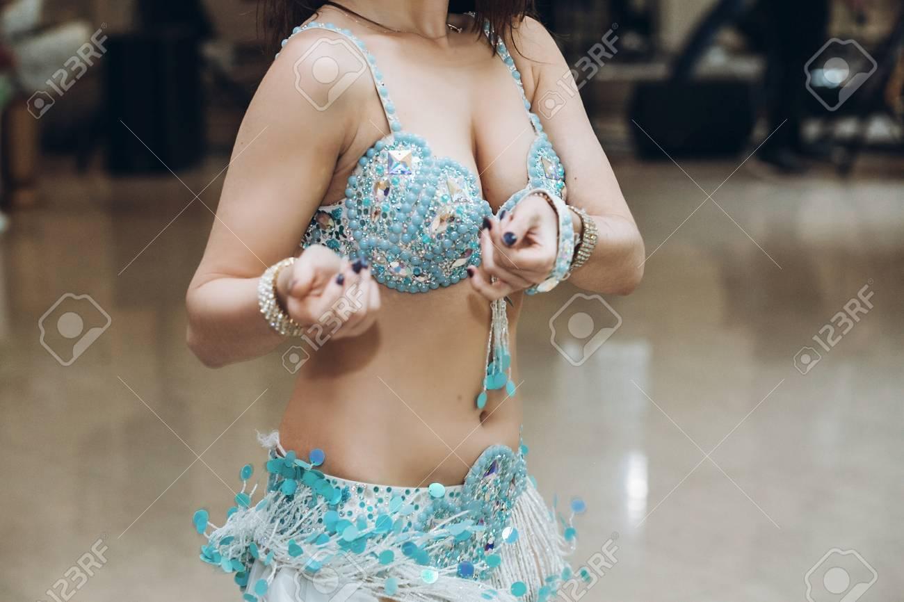 sexual belly dancer. eastern dancing. woman in blue costume..